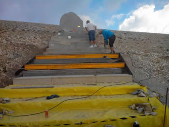 Fixing the memorial onto Mont Ventoux